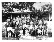 "George Washington Crowe Family Reunion – in front of George Washington Crowe and Mary King Crowe's ""home place."" George Washington Crowe is sitting in the left middle row in front of the two little girls.  Jim's father (Garrett Lee Davenport), his mother (Lottie May Cooper Davenport) and his older sister (Patricia Anne Davenport Huiet). are on the right side of the front row.  The picture was taken around 1939 which would make Patricia four years old at the time."